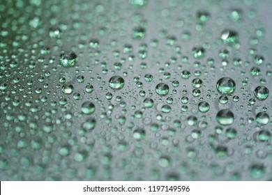 rain drops on car glass with hydrophobic coating macro photo