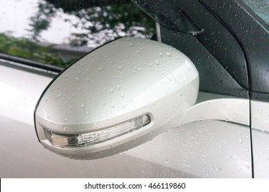 rain drops on car side view mirror