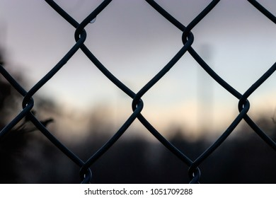 rain drops on chain link fence after a storm