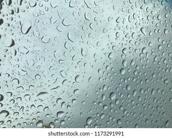 Rain drops on the mirror island. On window glass .