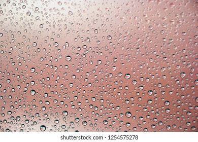 Rain drops on red glass