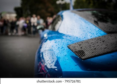 Rain drops on supercar carbon wing spoiler