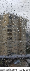 Rain drops on window. Black clouds on background with a rain drops - Shutterstock ID 1942194682