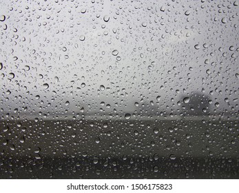 Rain drops on window glass, Can be used for display or background, Rainy season concept.