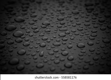 Rain drops on window. Window Glass Pear Island. Dark tone.