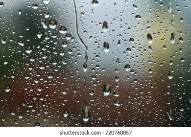 Rain drops on window glass , rainy day