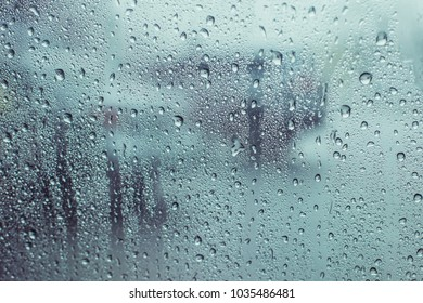 Rain drops water on car window background, view out of car now raining background, surface out of glass window car with rain drop water in the raining day
