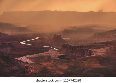 Rain falling on the Green River Overlook at Canyonlands National Park outside of Moab, Utah, USA