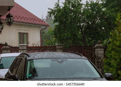 rain falls on the roof of the car