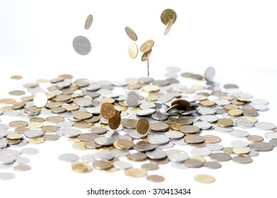Rain from Golden and silver Coins. Falling  on white background