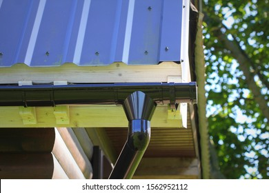 Rain Gutter Pipeline System Installation. Roofing Construction. Rain gutter system and roof protection from snow . Home Guttering, Gutters, Guttering , Drainage Pipe Exterior.