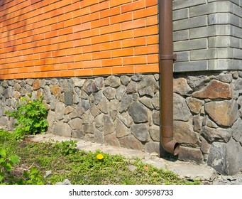 Rain gutter without any drainage systems near house foundation. Bad example.