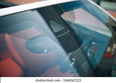 Rain and light sensor on the windshield of the car