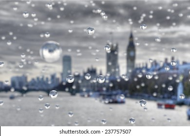 Rain in London. Rain drops focus the scene behind.
