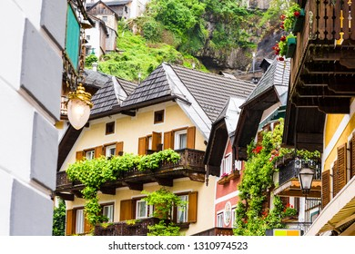 Rain and morning mist over the Austrian city of Hallstatt. Traditional Austrian medieval architecture in the Alps