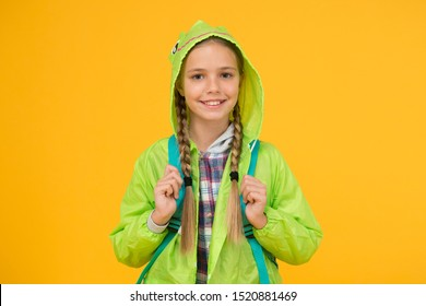 Rain is not hindrance. Waterproof cloak. Waterproof fabric for your comfort. Rainproof accessory. Schoolgirl hooded raincoat going to school. Waterproof clothes. Kid girl happy wear raincoat.