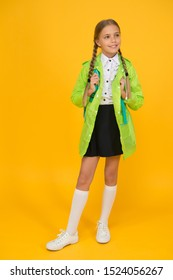 Rain is not hindrance. Waterproof cloak. Schoolgirl wear green raincoat going to school. Waterproof fabric for your comfort. Rainproof accessory. Waterproof clothes. Kid girl happy wear raincoat.