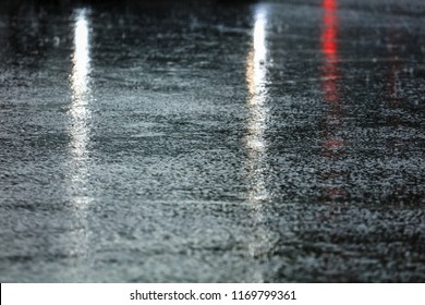 Rain on the asphalt road as background