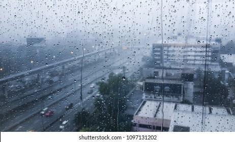 Rain on the window, rain on the window, outside the city window, in the city rain