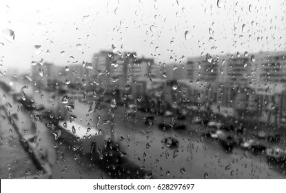 Rain On The Window Outside City In