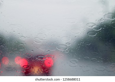 Rain, Rain on the windshield view from inside the car at road way traffic jam, rainy season, rainy storm (selective focus)