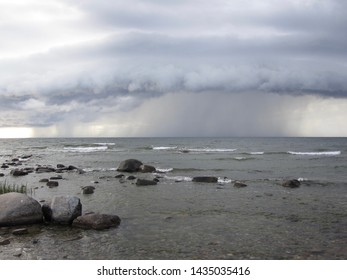 Rain over the Baltic Sea on Northwest Gotland falling out of dark clouds