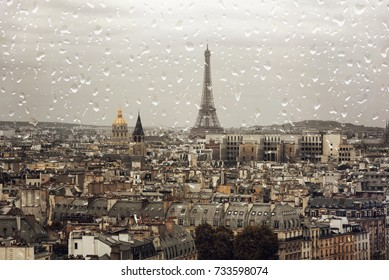 Rain in Paris, Eiffel tower in autumn day, rainy day over the city