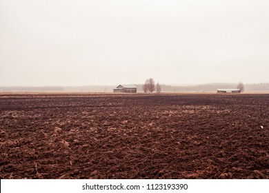 The rain pours over the tiny old barn houses on the muddy fields of the Northern Finland. The spring has not started yet.