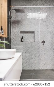 Rain shower with herringbone marble feature tile wall