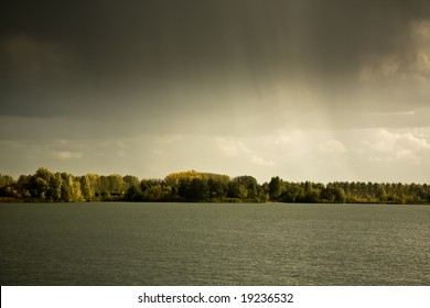 Rain and storm clouds above lake