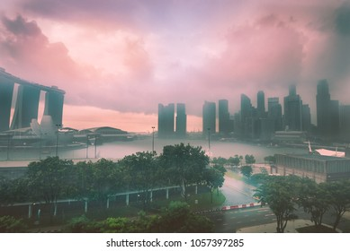 Rain and storm clouds at dusk over Marina Bay in Singapore.