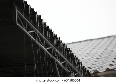 rain storm with metal sheet roof,rainwater flows down the roof
