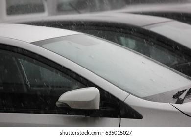rain storm,rain water falling down the car. raining  in cars park