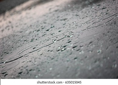 rain storm,rain water falling down car windshield