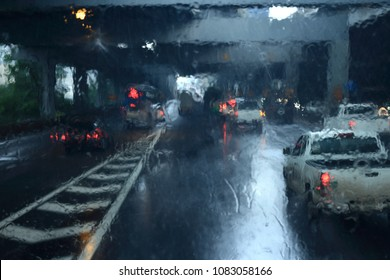 rain strom weather on windshield. visual obstruction poor visibility traffic on fee toll  highway.