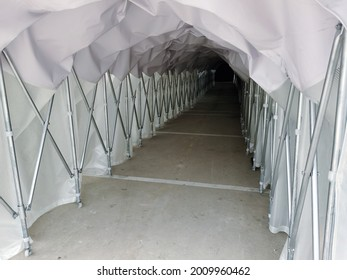 Rain tarp tunnel for walking, Waterproof and sunproof walkway, Tunnel path in canvas tent, Tent canvas tunnel with a metal frame, Plastic tunnel guard against rain or sunlight