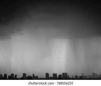 Rain Water drop background of rainny on glass with outdoor black and white sky cloud storm on city building