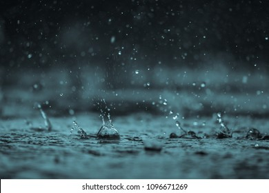 Rain water drop falling  on concrete floor in rainy season
