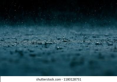 The rain water drop falling on the floor in rainy season