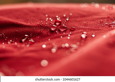 Rain Water droplets on  red waterproof fabric