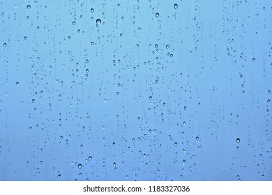 Rain water drops droplets on window glass texture background