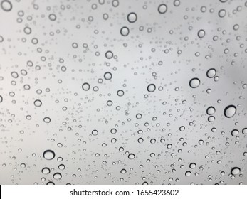 rain water drops on transparent glass surface.
