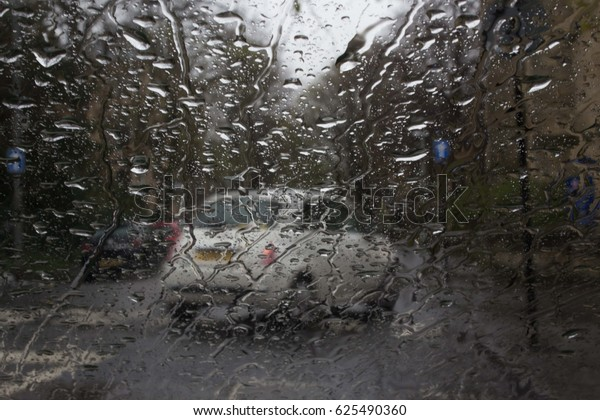 Rain Window with Blur White Car on Street View, Water Drops of Rain on a Window Glass