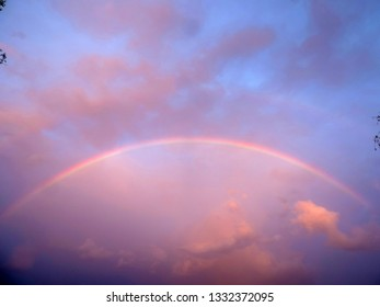 Rainbow across the whole sky with pink clouds. Lightning Ridge, New South Wales, Australia