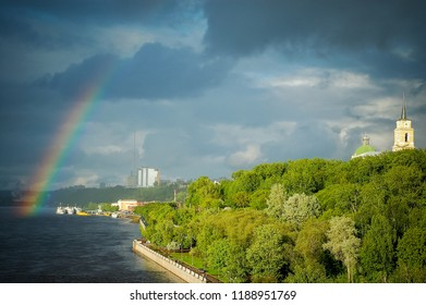 Rainbow after the rain in the background of the embankment of the river Kama, Perm. Perm region, Russia. June 2008.