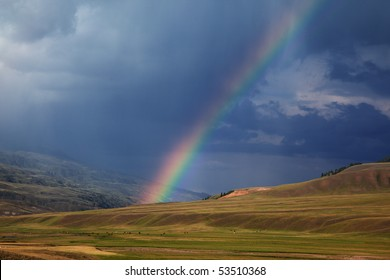 Rainbow after storm in the mountains of Almaty region national park Assy