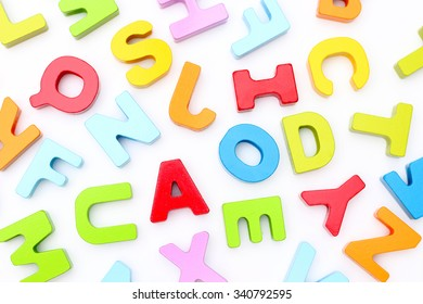 Rainbow Alphabet scattered on a white background