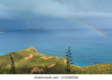 Rainbow appears over Cape Reinga at the northern-most part of New Zealand