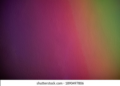 Rainbow background. Color gradient. Grain texture. Defocused vibrant magenta pink purple orange green stripes pattern abstract banner with copy space.