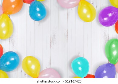 Rainbow ballon on the wooden floor. High top view. Holiday, carnival or birthday party concept.